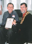 Mayor Garry Moore presents Peace City Award to Dr Neil Cherry